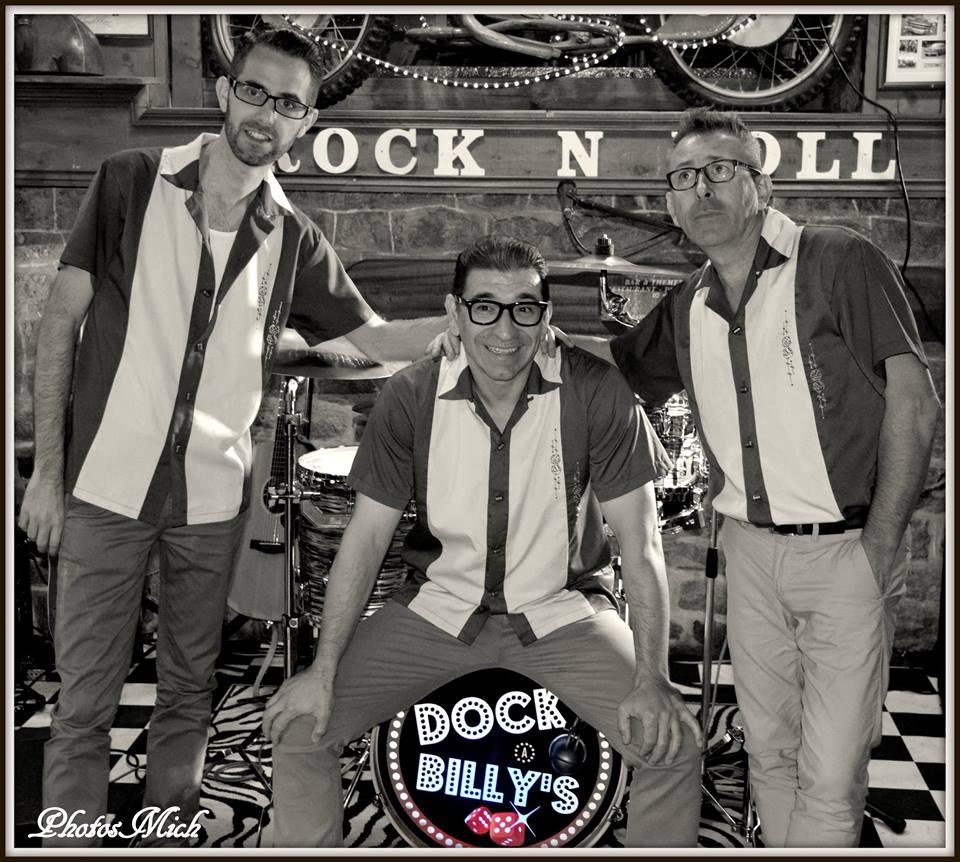 Êtes vous prêts à redécouvrir la période Rock N roll, Fifties avec les Dock A Billy's ? C'est ce que nous vous proposons dans le cadre d'une soirée dansante, à la façon Elvis Presley, les Stray Cats, Chris Isaak… Festival de tubes incontournables maniés avec fougue et virtuosité, les Dock A Billy's ont l'art et la manière de lier le Rock'N'Roll au Swing. En 20 ans d'expérience, le trio a sillonné une bonne partie de la France à travers les cafés concerts, les festivals, les soirées privées, les cabarets… Formé en 1995, Dock A Billy's est un trio composé de 3 musiciens intermittents du spectacle: Guitare Contrebasse Batterie. ils ont fait de nombreuses premières parties d'artistes comme: Darrel Higham, Crazy Cavan, Go Getters…